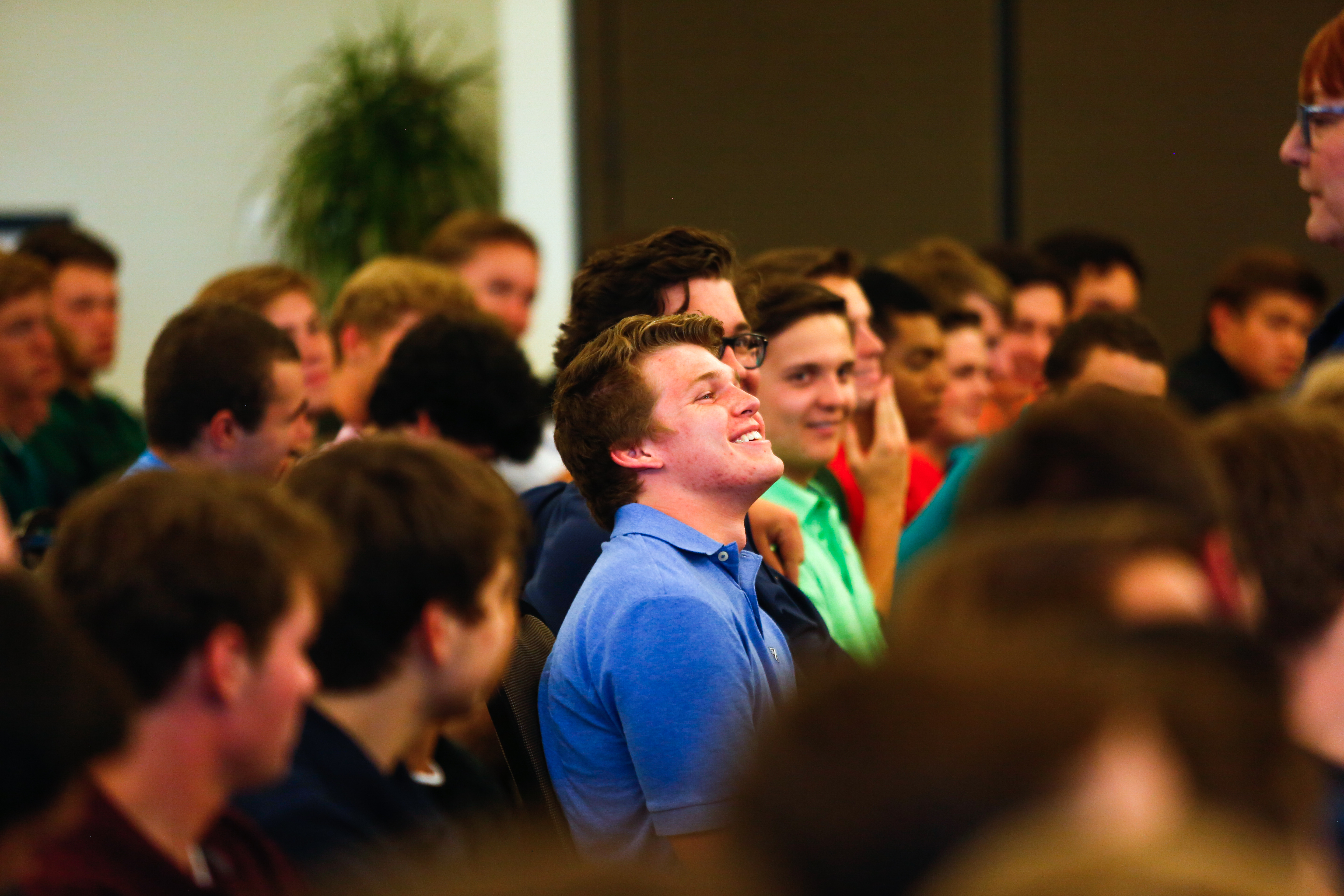 New fraternity members being education on fraternity values.