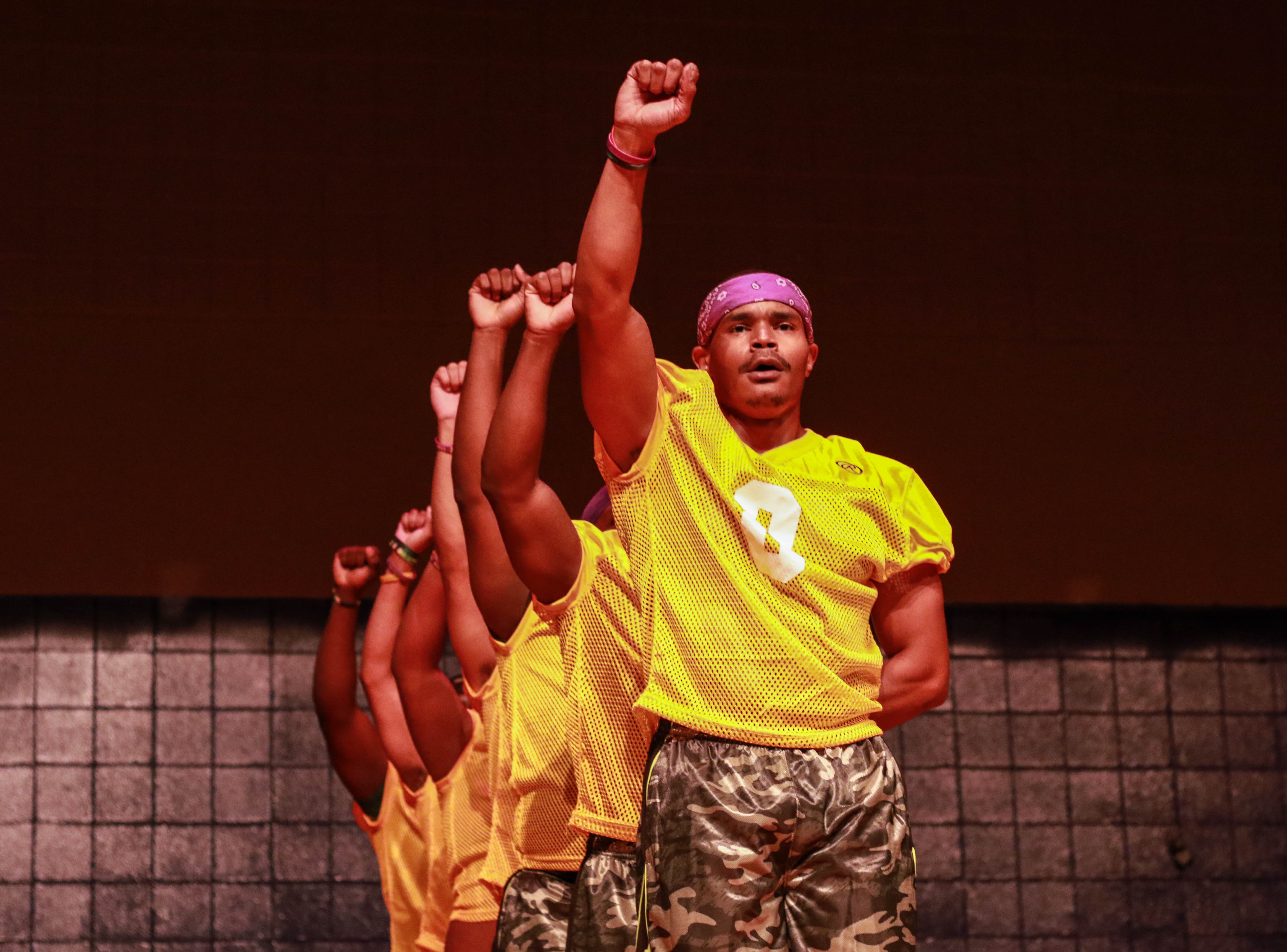 Men at the NPHC Step Show performing.