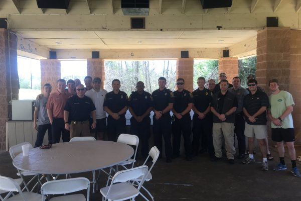Fraternity men and first responders pose for a picture at the IFC First responders luncheon