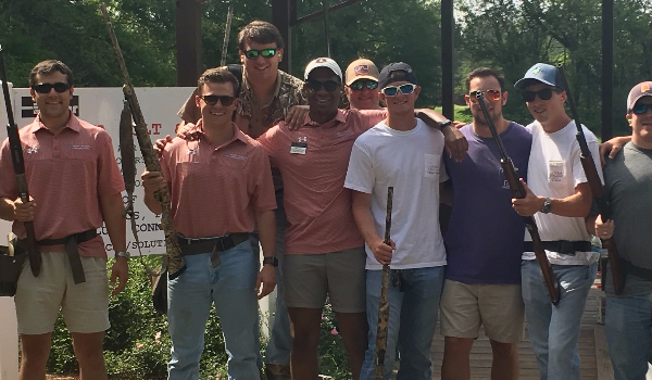 Fraternity men posing for a picture at the Annual IFC Skeet Shoot