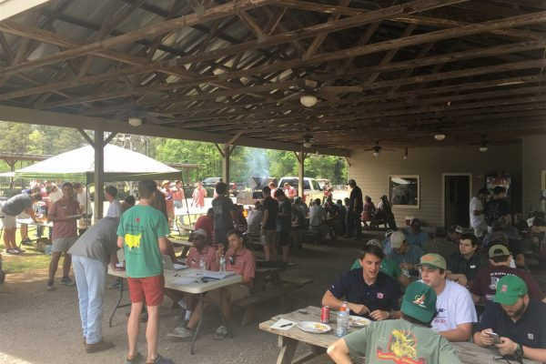 Fraternity Men eating lunch at the Annual IFC Skeet Shoot